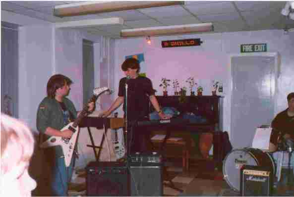 Paul Gooding and me playing at our first ever gig, October 1991